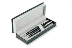 Pens in a box. On a white background royalty free stock image