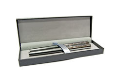 Pens in a box. A pens in a box royalty free stock images