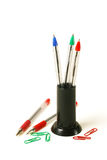 Pens and clips. Paperwork equipment. RGB pens and clips isolated on white background Stock Photos