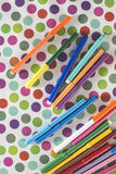 Pens on colorful background Stock Photos