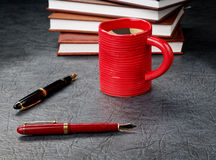 Pens with a cup of coffee Royalty Free Stock Image