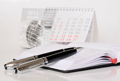Pens on a diary. Two pens on an opened diary Royalty Free Stock Image