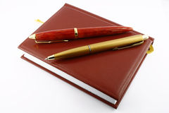 Pens and diary. It is isolated on a white background. A close up Royalty Free Stock Photography