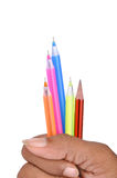 Pens on hand. Image detail of colorful pens and pencil Royalty Free Stock Images