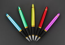 Pens logo. Colorful pens on a dark background Stock Image
