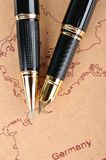 Pens and map Royalty Free Stock Photo