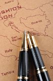 Pens and map Royalty Free Stock Images