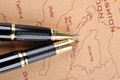 Pens and map Royalty Free Stock Photos