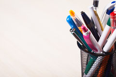 Pens. Metal holder with colorful pens royalty free stock photo