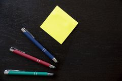 Pens and note stickers. To personalize with the logo of your company Royalty Free Stock Image