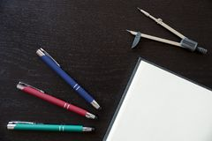 Pens, notebook and drawing compass to personalize. With the logo of your company Stock Image