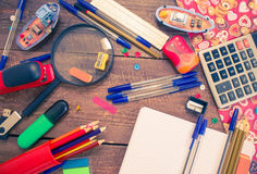 Pens, notebook, magnifier, calculator and pencils. Royalty Free Stock Images