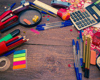 Pens, notebook, magnifier, calculator and pencils. Royalty Free Stock Image