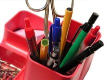Pens in pencil holder. Writing tools - pens, pencils and scissors in pencil holder royalty free stock image