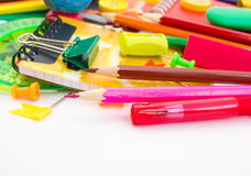 Pens, pencils, erasers, with smileys and a set of notebooks. Stock Photography