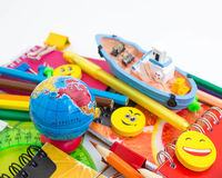 Pens, pencils, erasers, with smileys and a set of notebooks. Royalty Free Stock Photo