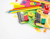 Pens, pencils, erasers, with smileys and a set of notebooks. Royalty Free Stock Photos