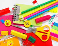 Pens, pencils, erasers, with smileys and a set of notebooks. Stock Photo