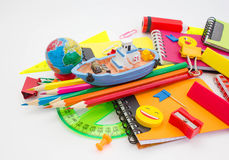 Pens, pencils, erasers, with smileys and a set of notebooks.