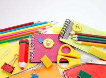 Pens, pencils, erasers, with smileys and a set of notebooks. Royalty Free Stock Image
