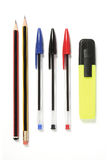 Pens, pencils and a Highlighter. Pens lined up, ready for action. Two pencils, three ball point pens and a hi-lighter pen. These shapes are standard in the UK stock photo