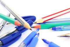 Pens and pencils on white. Pens and pencils isolated on white background Royalty Free Stock Photography