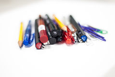 Pens and pencils in white background Royalty Free Stock Photos