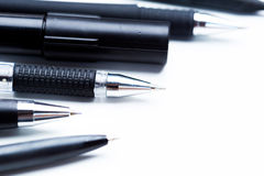 Pens and pencils. On white background stock photography