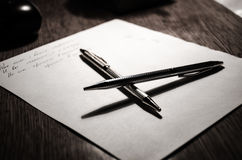 Pens. Read between the lines, draw lines, leased lines Stock Photography