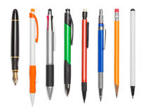 Pens. Various Pens and Pencils Isolated on White Background royalty free stock photos