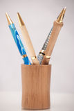 Pens in wooden jar Stock Image