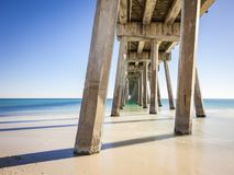 Pensacola Beach Fishing Pier. Pensacola Beach Pier is located on Casino Beach. The pier is 1,471 feet long, and boasts some of the best fishing in the area. The Stock Photography