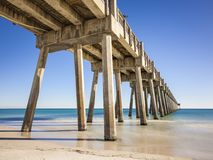 Pensacola Beach Gulf Fishing Pier. Pensacola Beach Pier is located on Casino Beach. The pier is 1,471 feet long, and boasts some of the best fishing in the area Stock Photos