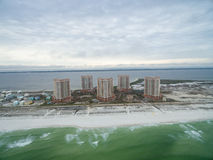 PENSACOLA, FLORIDA - APRIL 13, 2016: Flying over Gulf of Mexico and Portofino Island Resort Buildings with sandy beach in Pensacol Stock Images