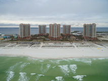 PENSACOLA, FLORIDA - APRIL 13, 2016: Gulf of Mexico and Portofino Island Resort Buildings with sandy beach in Pensacola. Royalty Free Stock Image