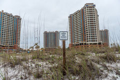 PENSACOLA, FLORIDA - APRIL 14, 2016: Keep of Dunes sign in Pensacola Beach. Portofino Tower in Background Stock Photo