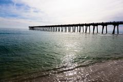 Pensacola pier with sun shining through Stock Images
