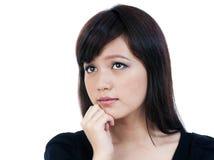 Pensamento asiático novo da mulher fotos de stock royalty free