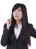 Pensamento asiático novo das mulheres de negócios foto de stock