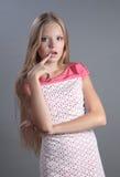 Pensamento bonito da menina. Fotos de Stock