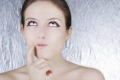 Pensamento bonito da mulher nova Fotos de Stock