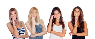 Pensamento bonito de quatro jovens mulheres imagens de stock