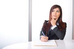 Pensamento da mulher de negócio Fotografia de Stock