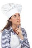 Pensamento da mulher do cozinheiro Fotos de Stock Royalty Free