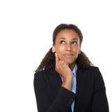 Pensamento de sorriso da mulher de negócio fotografia de stock royalty free