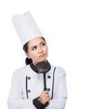 Pensamento do cozinheiro chefe da jovem mulher Fotografia de Stock Royalty Free