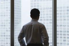 Pensamento do homem de negócios Imagens de Stock