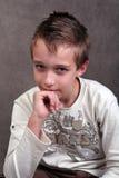 Pensamento do menino Foto de Stock