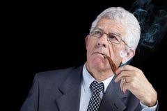 Pensamento sênior do homem de negócios Imagem de Stock Royalty Free