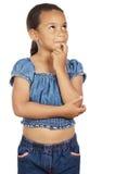 Pensamiento adorable de la muchacha Fotografía de archivo